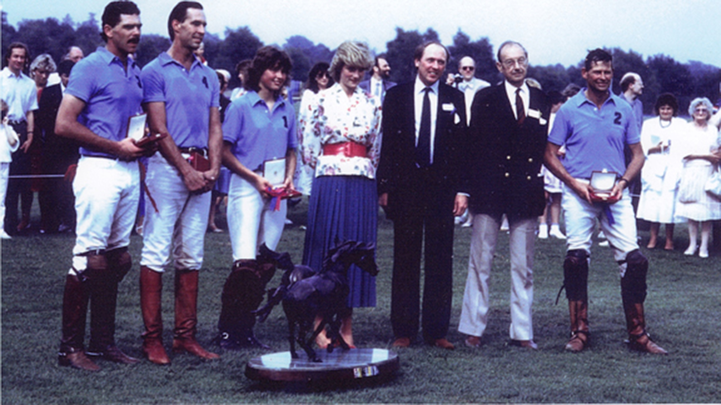 Victoria and her father Peter Grace OBE, being awarded the Dorchester Trophy at Guards Polo Club by Princess Diana having played against HRH Prince of Wales