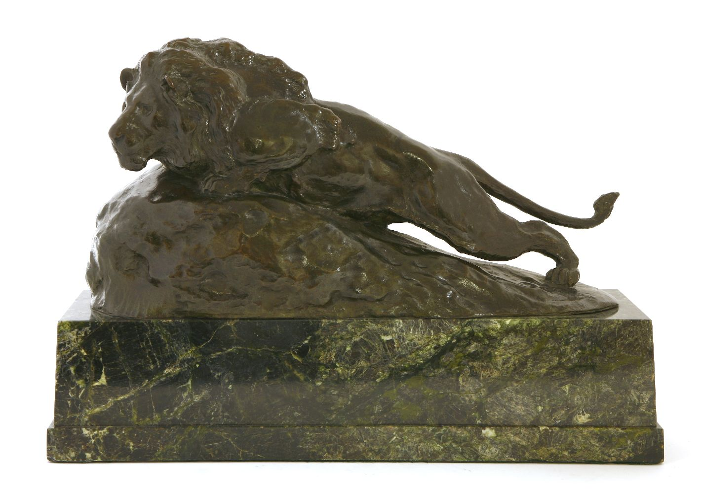 Herbert Thomas Dicksee RE (1862-1942) PROWLING MALE LION CROUCHING ON A GENTLY ANGLED ROCK