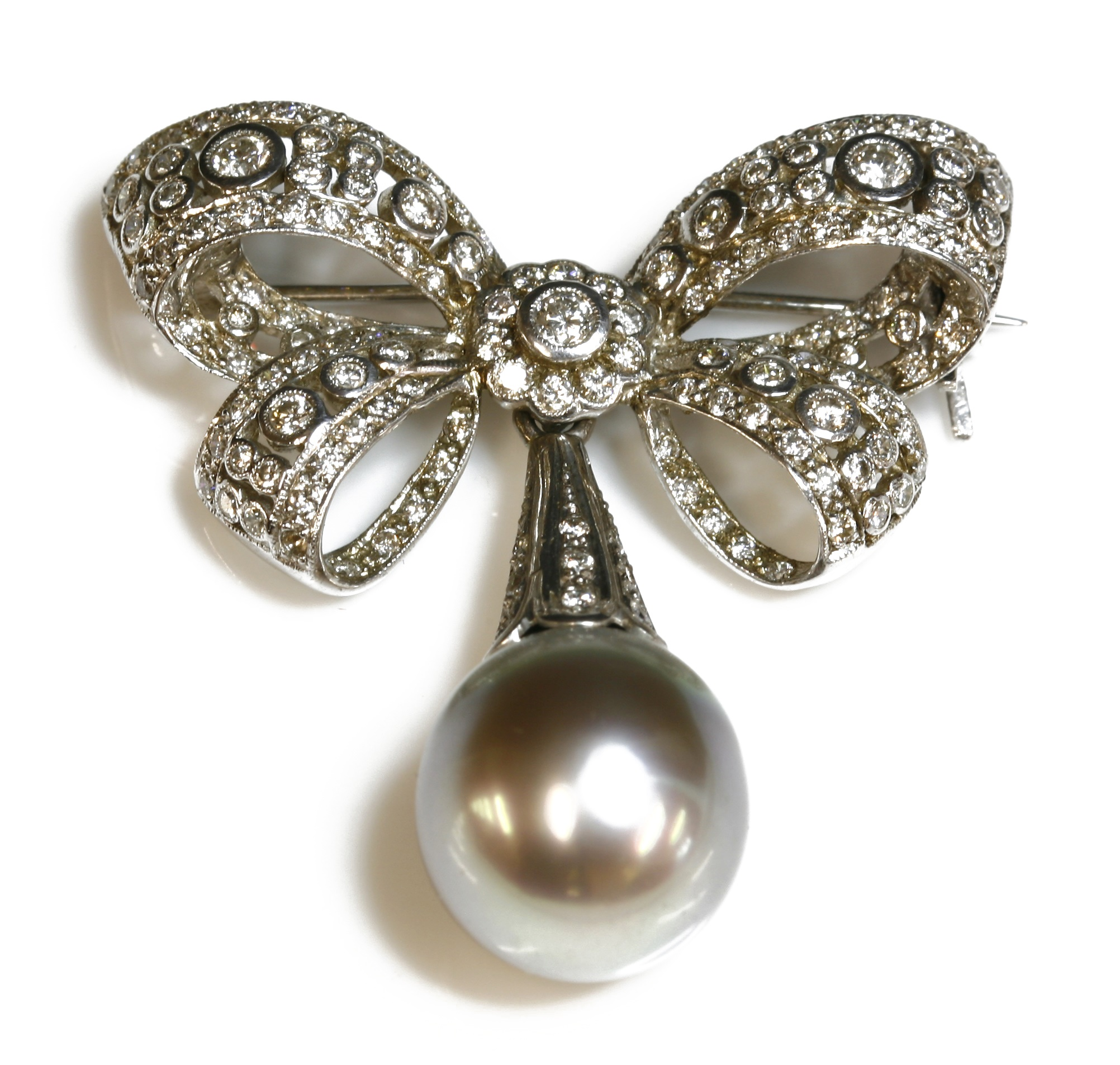 A white gold, Tahitian cultured pearl and diamond bow brooch