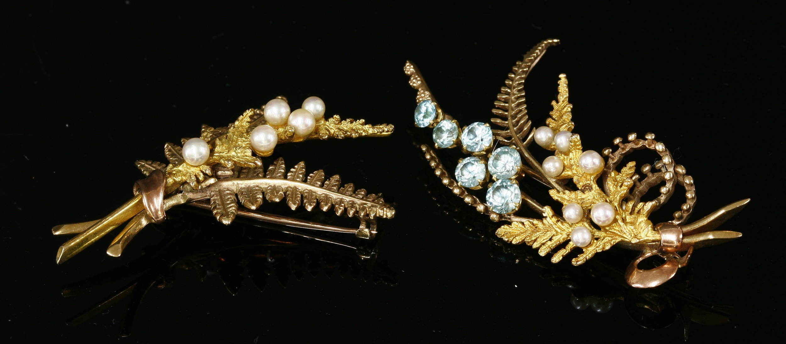 A 9ct two coloured gold blue zircon and cultured pearl fern spray brooch, by Alabaster and Wilson