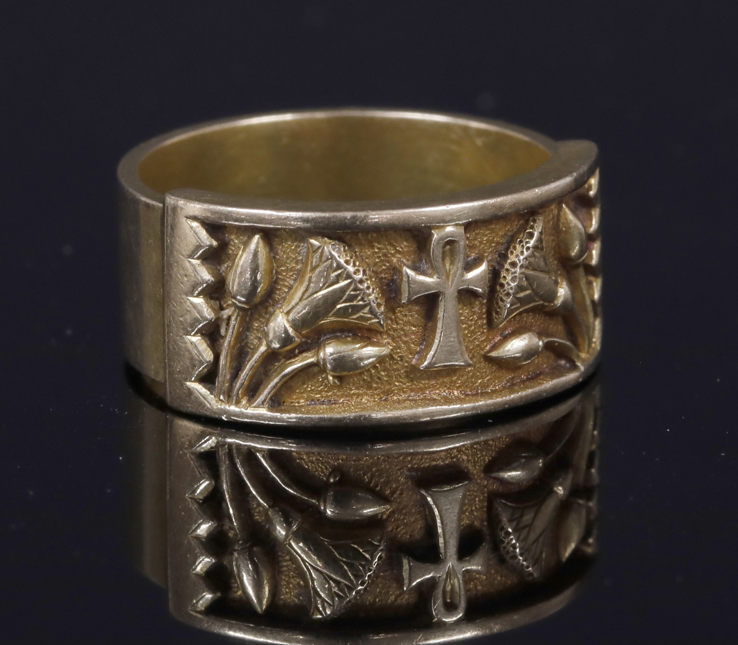 An Egyptian Revival ring, c.1900, with ankh and lotus motifs. The ankh hieroglyph represents the word for life, whilst the lotus flower was associated with Sun god Atum-Ra and symbolised creation and rebirth.  Lot 145, Fine Jewellery Sale, 19th November 2019 Hammer £380