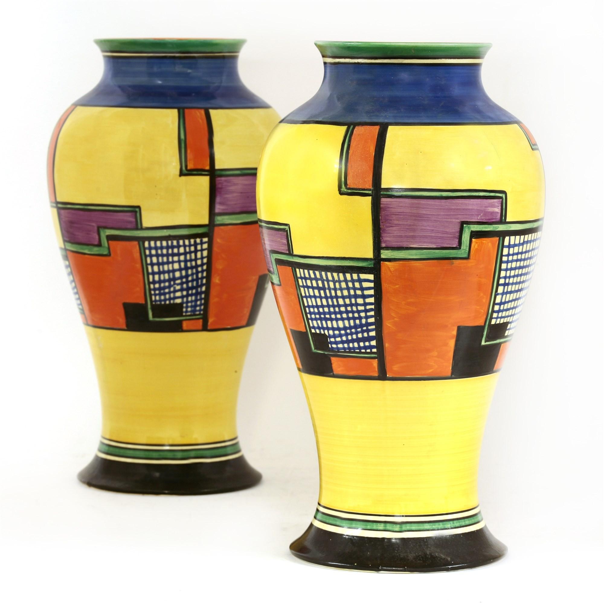 A pair of Clarice Cliff vases, c.1930. Estimate £2,000-3,000