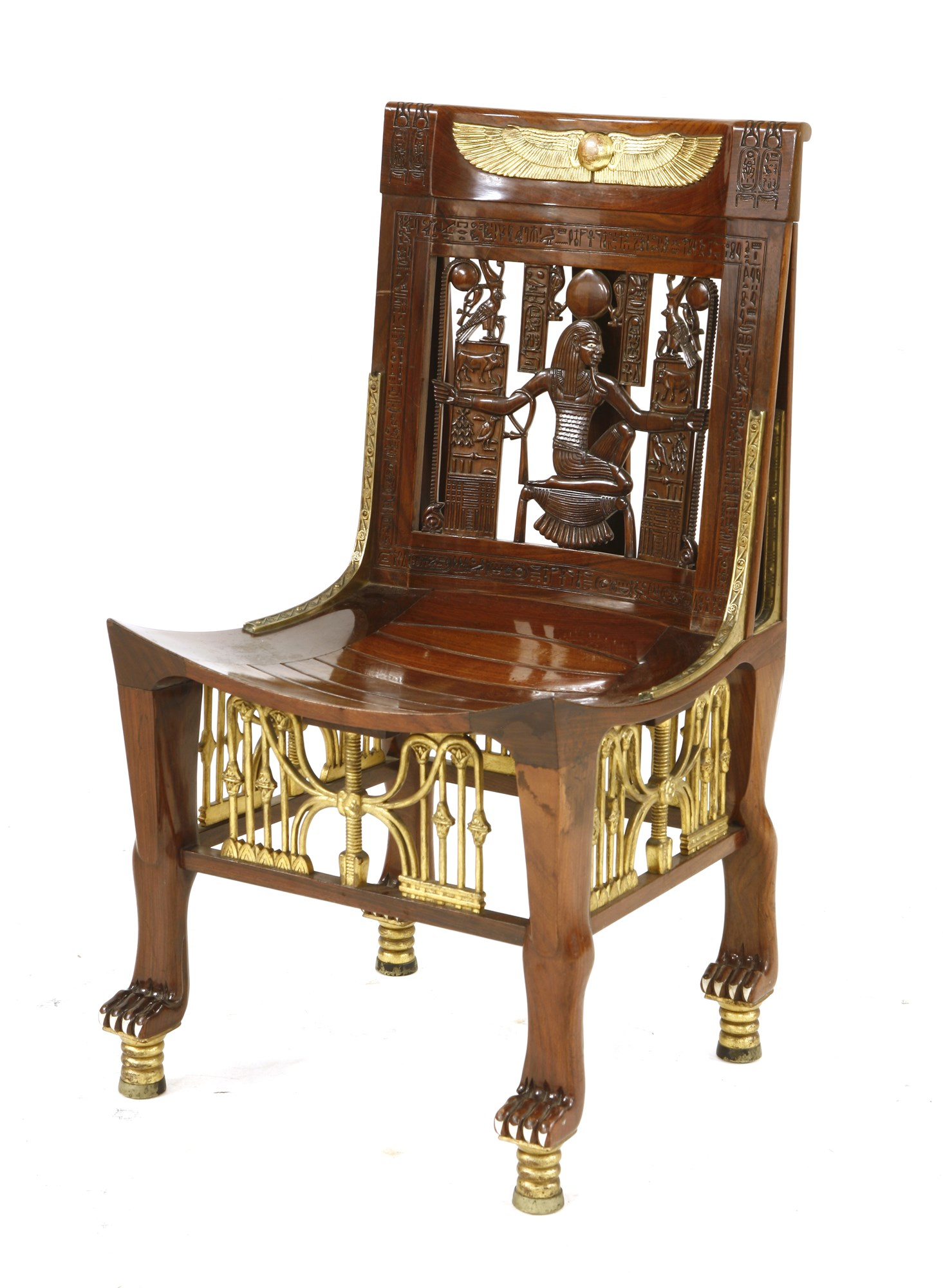 A splendid example of 'Egyptomania' - a very high quality copy of the bone-inlaid and parcel gilt ceremonial chair found in the tomb of Tutankhamen in 1922. It carries an auction estimate of £10,000-15,000