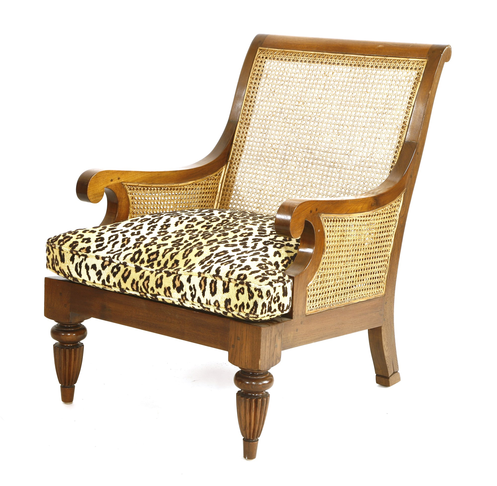 A teak chair with faux leopard cushion cover