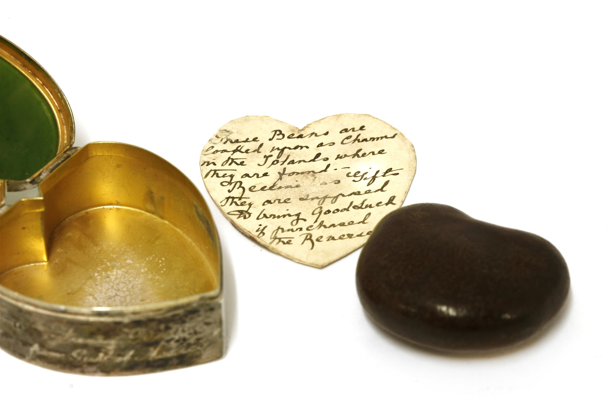 Birmingham 1905 silver and nephrite heart shaped box containing a bean from the Caribbean