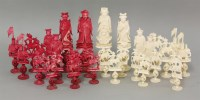 Lot 94 - A Chinese export ivory figural chess set