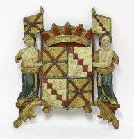 Lot 91 - A carved and polychrome coat of arms