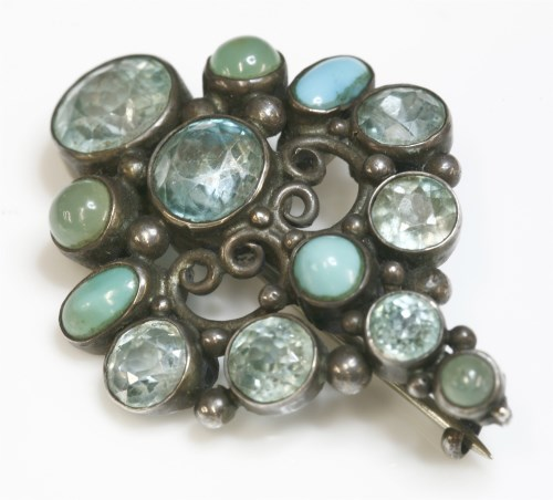 Lot 16 - An Arts and Crafts silver and gemstone brooch