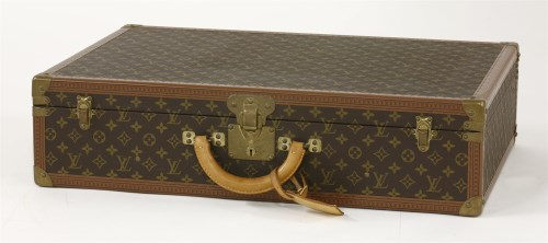 Lot 177-A Louis Vuitton hinged hard sided suitcase