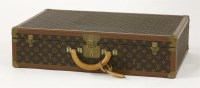 177 - A Louis Vuitton hinged hard sided suitcase