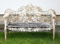 461 - A Coalbrookdale design cast iron garden bench