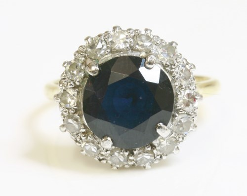 Lot 444-A sapphire and diamond circular cluster ring