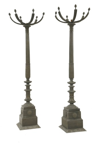 630 - A pair of bronze column uplighters each with a square base and a fluted tapering column