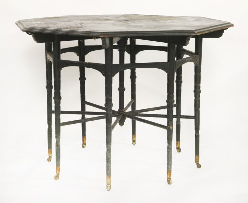 Lot 87-An ebonised coromandel and inlaid octagonal centre table
