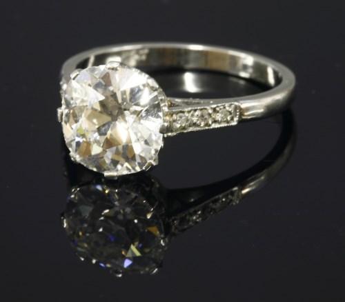 Lot 350 - A single stone diamond ring with diamond set shoulders