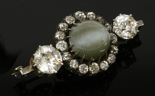 Lot 345-A late Victorian chrysoberyl cat's-eye and diamond cluster