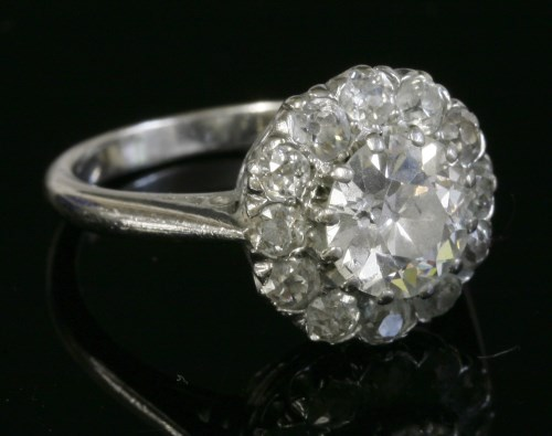 Lot 397 - A white gold diamond set cluster ring