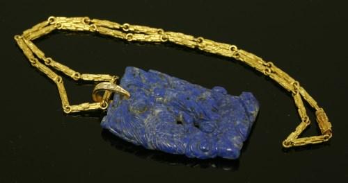 479 - A cased lapis lazuli and diamond pendant by Andrew Grima