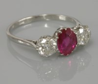 Lot 7 - A three stone synthetic ruby and diamond ring
