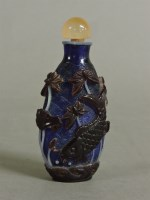 Lot 60 - A Chinese overlaid glass scent bottle and stopper