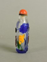 Lot 58 - A Chinese overlaid glass scent bottle and stopper
