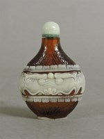 Lot 59 - A Chinese overlaid brown glass scent bottle and stopper