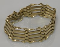 Lot 11 - A 9ct gold five straight and twisted bar gate bracelet