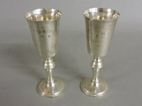 Lot 74 - A pair of 20th century silver goblets