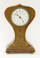 Lot 35 - An Art Nouveau mahogany boxwood and brass inlaid mantel clock with an enamelled dial