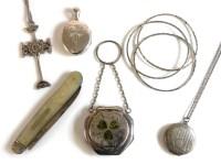 Lot 79 - A silver decorative cross on chain