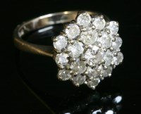 Lot 37 - An 18ct white gold diamond set hexagonal cluster ring