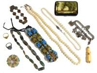 Lot 76 - A silver curb link bracelet charm bracelet