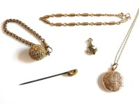 Lot 18 - A gold belcher chain with gold Pousse ball fob