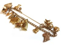 Lot 45 - A 9ct gold curb link charm bracelet