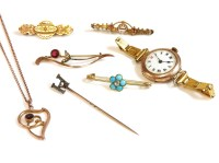 Lot 53 - A gold diamond and turquoise 'forget me not' bar brooch
