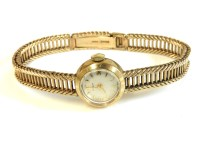 Lot 1 - A 9ct gold ladies Tissot mechanical bracelet watch
