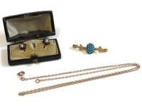 Lot 52 - A pair of gold cushion cut diamond and black enamel studs