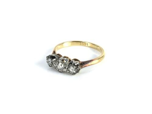Lot 25-A gold three stone diamond ring