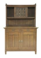 Lot 36 - A German oak dresser