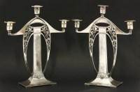 Lot 7 - A pair of Art Nouveau silver metal candelabra