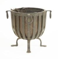 Lot 43 - An Arts & Crafts iron log bin