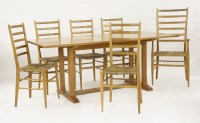 Lot 73 - An oak refectory table and five rush-seated chairs