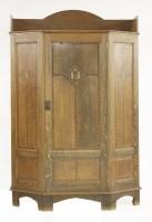 Lot 48 - An Arts and Crafts oak wardrobe