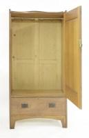 Lot 50 - An Arts and Crafts oak wardrobe