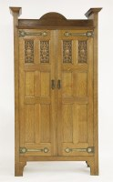 Lot 52 - An Arts and Crafts oak hall cupboard