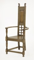 Lot 69 - An Arts and Crafts oak armchair