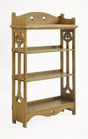 Lot 71 - An Arts and Crafts oak four-tier open bookcase