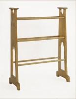 Lot 77 - An Arts and Crafts oak towel rail