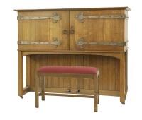 Lot 78 - An Arts and Crafts oak 'Manx' upright piano