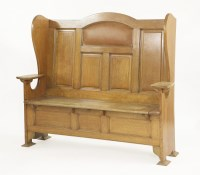 Lot 82 - An Arts and Crafts oak settle